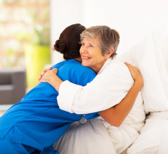 a caregiver looking tenderly at her patient