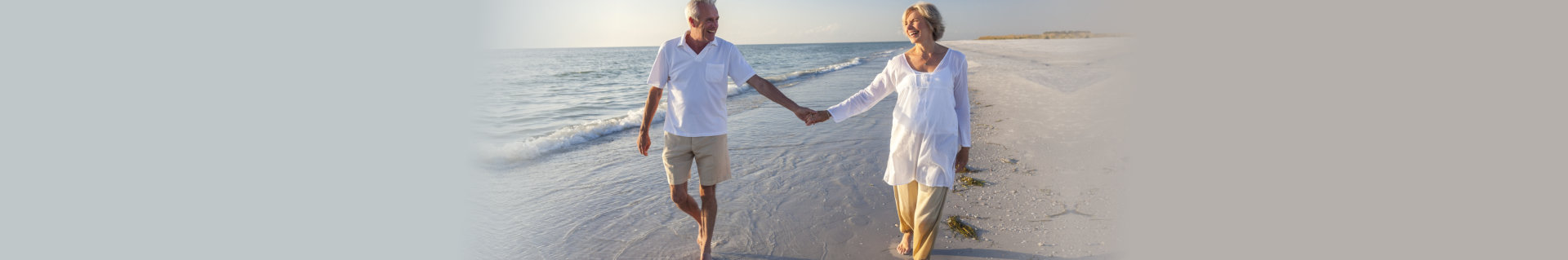 couple senior walking at beach