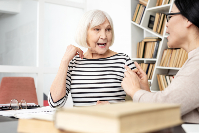 pleasant senior woman opening mouth and pronouncing words
