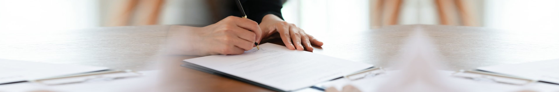 ropped image young woman signing business agreement with partner